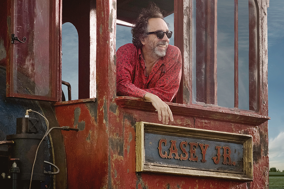 "GOTTA FLY – Visionary filmmaker Tim Burton helms the live-action reimagining of Disney's 1941 animated classic ""Dumbo."" ""'Dumbo' was always one of my favorite Disney films,"" said Burton. ""We're trying to give it the same heart, feeling and emotion that we all loved about the original."" Starring Colin Farrell, Michael Keaton, Danny DeVito, Eva Green, Nico Parker and Finley Hobbins, ""Dumbo"" is currently in production in England. © 2017 Disney Enterprises, Inc. All Rights Reserved."